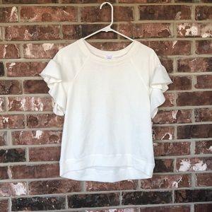 A short sleeved, white 'blouse'
